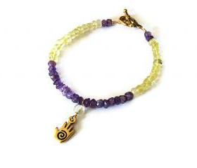 Charm beaded bracelet. Hamsa and quarts bracelet.